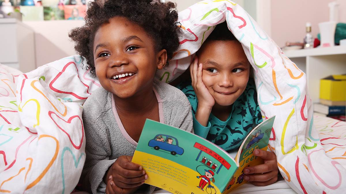 Children in PJs reading Car Car Truck Jeep