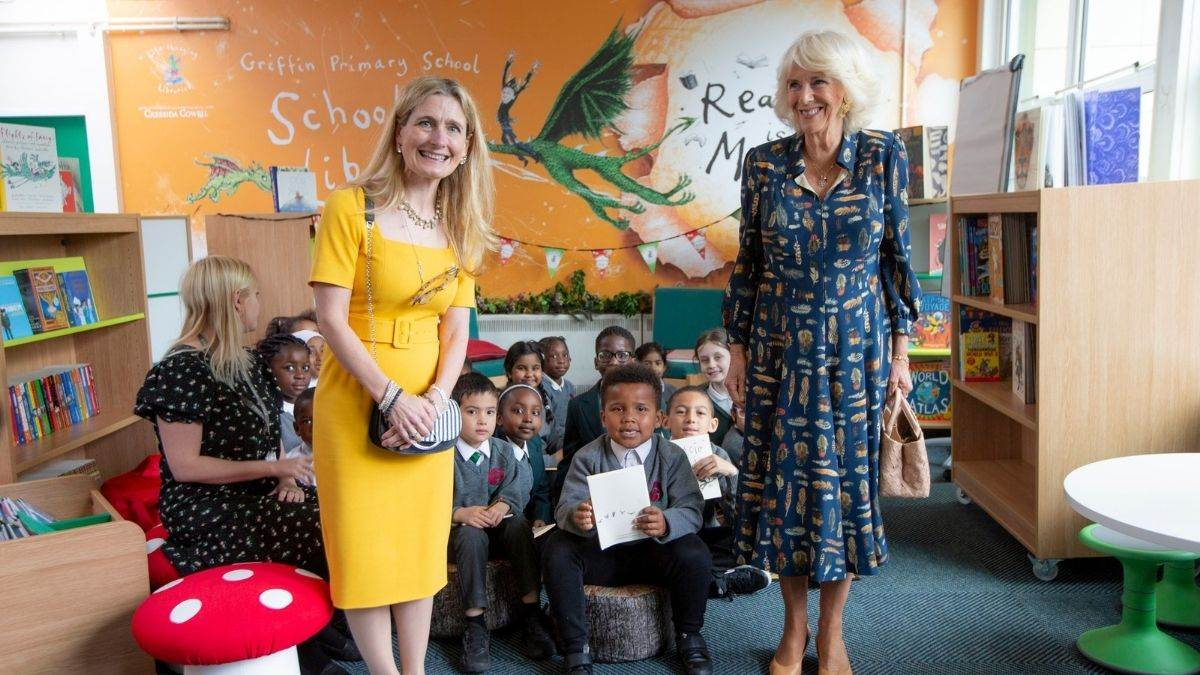 Cressida Cowell and the Duchess of Cornwall at the launch of a new primary school library