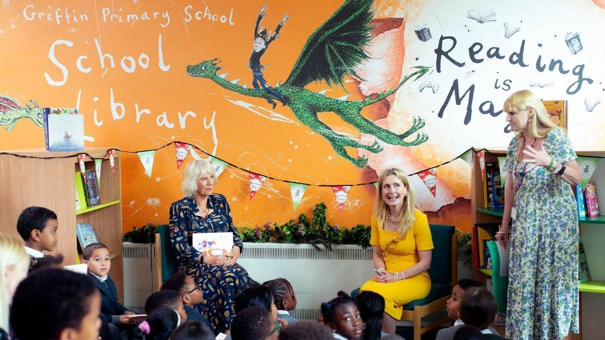 Children's Laureate Cressida Cowell and HRH The Duchess of Cornwall at Griffin School's new library. Artwork on wall designed by Promote Your School. Photography by David Bebber