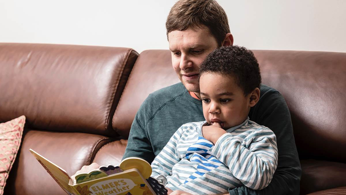 A man reading to a child