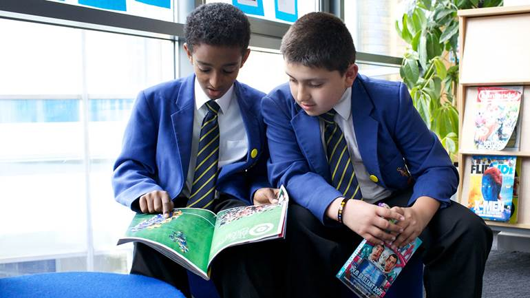 Boys reading in library