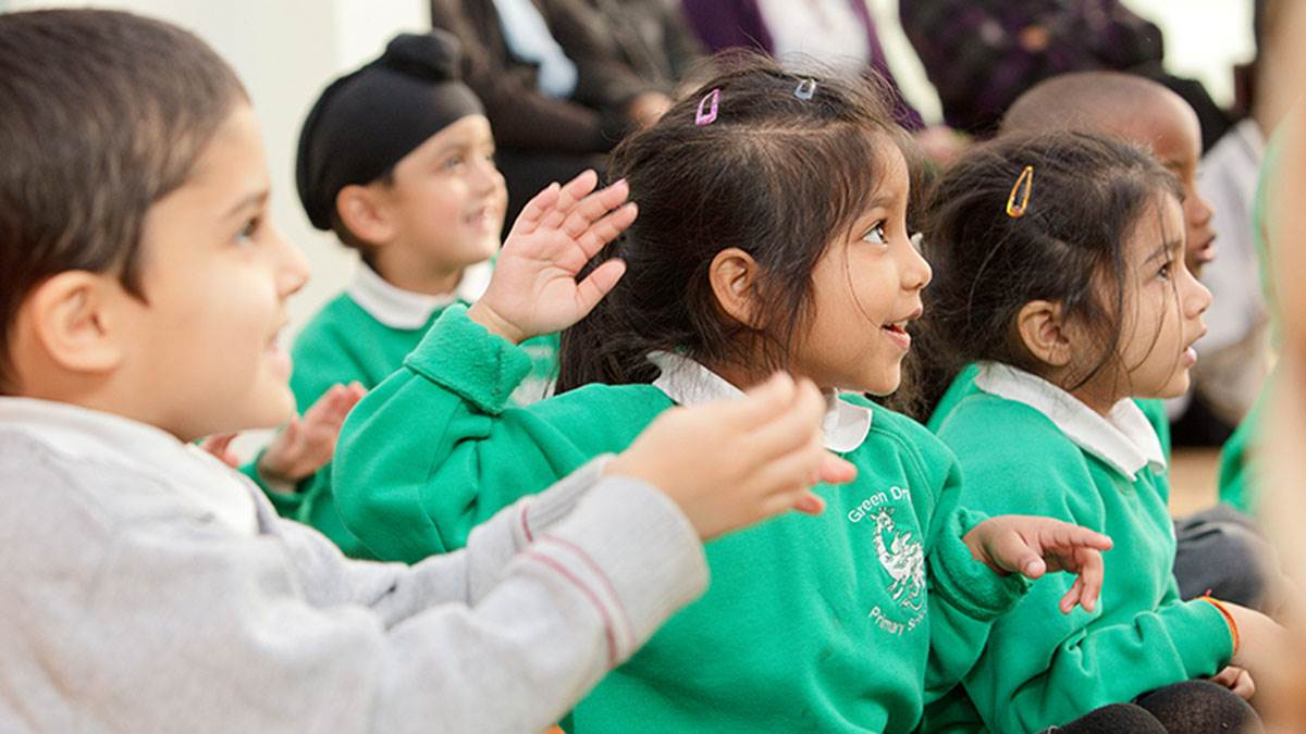 Primary school children looking excited