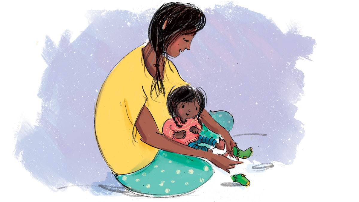 An illustration of a woman putting socks on her baby.