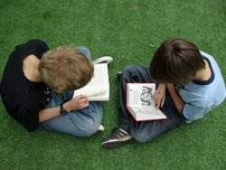 Boys reading outside