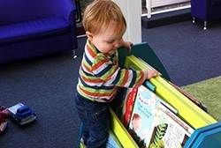 Kate's little boy, Albie, enjoying his local library