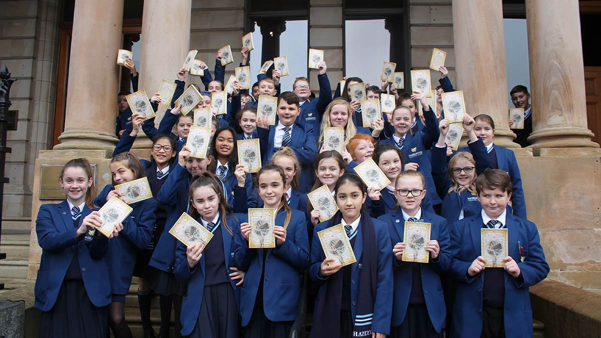 Pupils with their books at the Titanic book event in Belfast