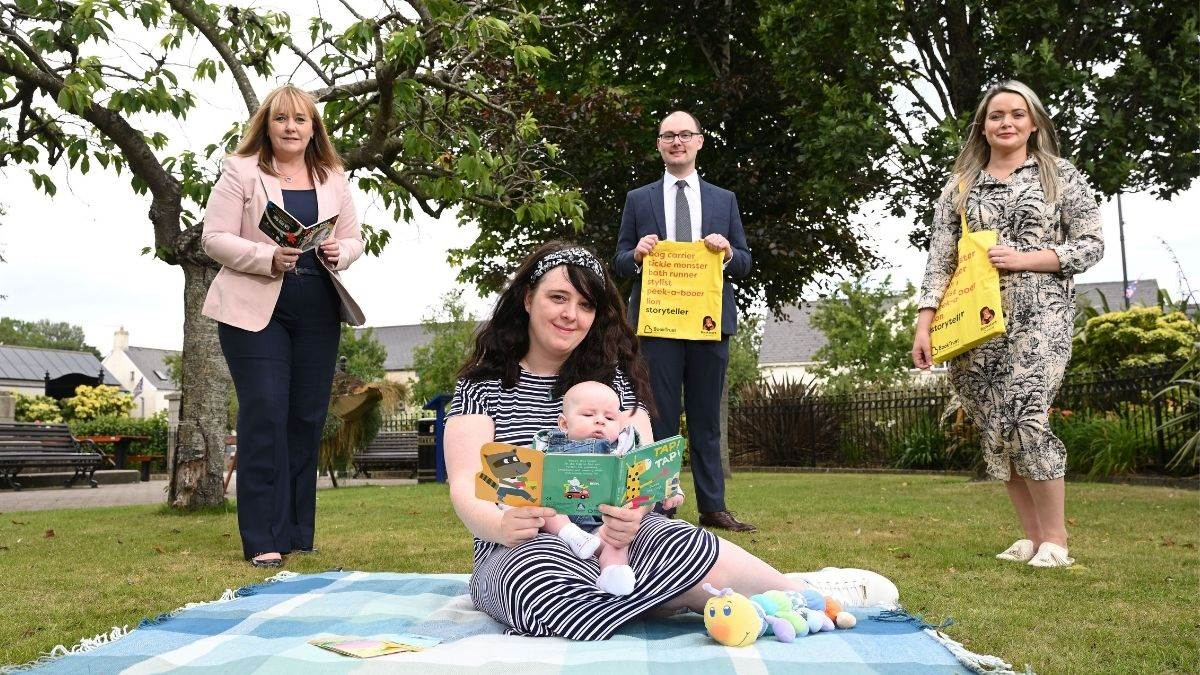 From L-R: Education Minister Michelle McIlveen; mum Judith and baby Eric; Chris Eisenstadt, Director of BookTrust Northern Ireland office; student Health Visitor Laura Gallagher.