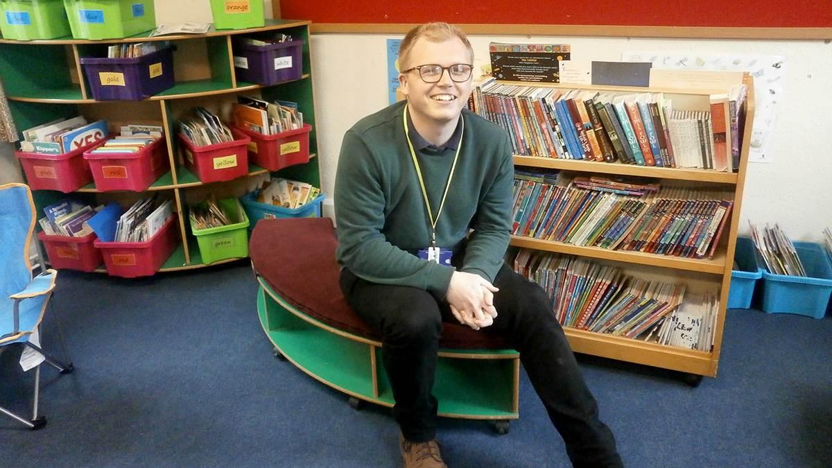 English teacher Charlie Hield in school library