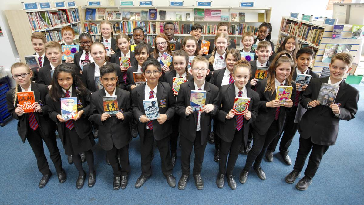 Bookbuzz students with their chosen books