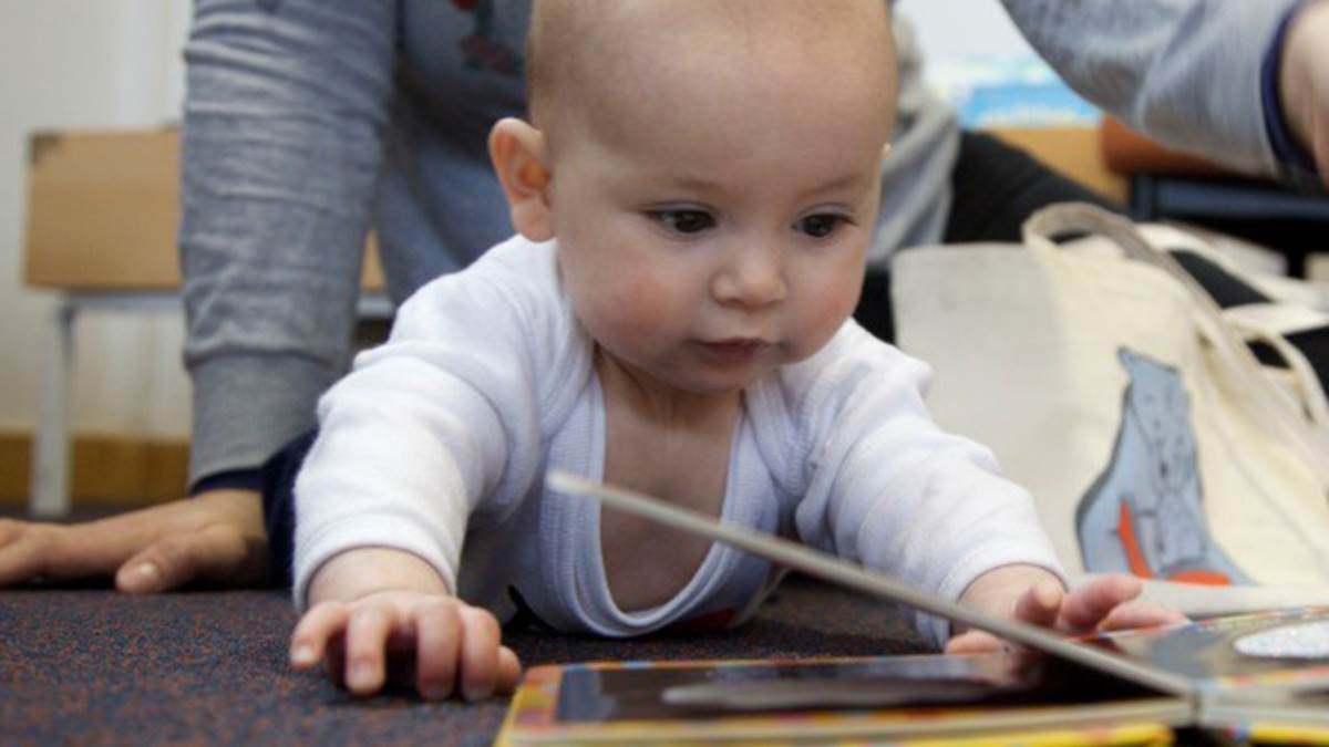 Crawling baby with book