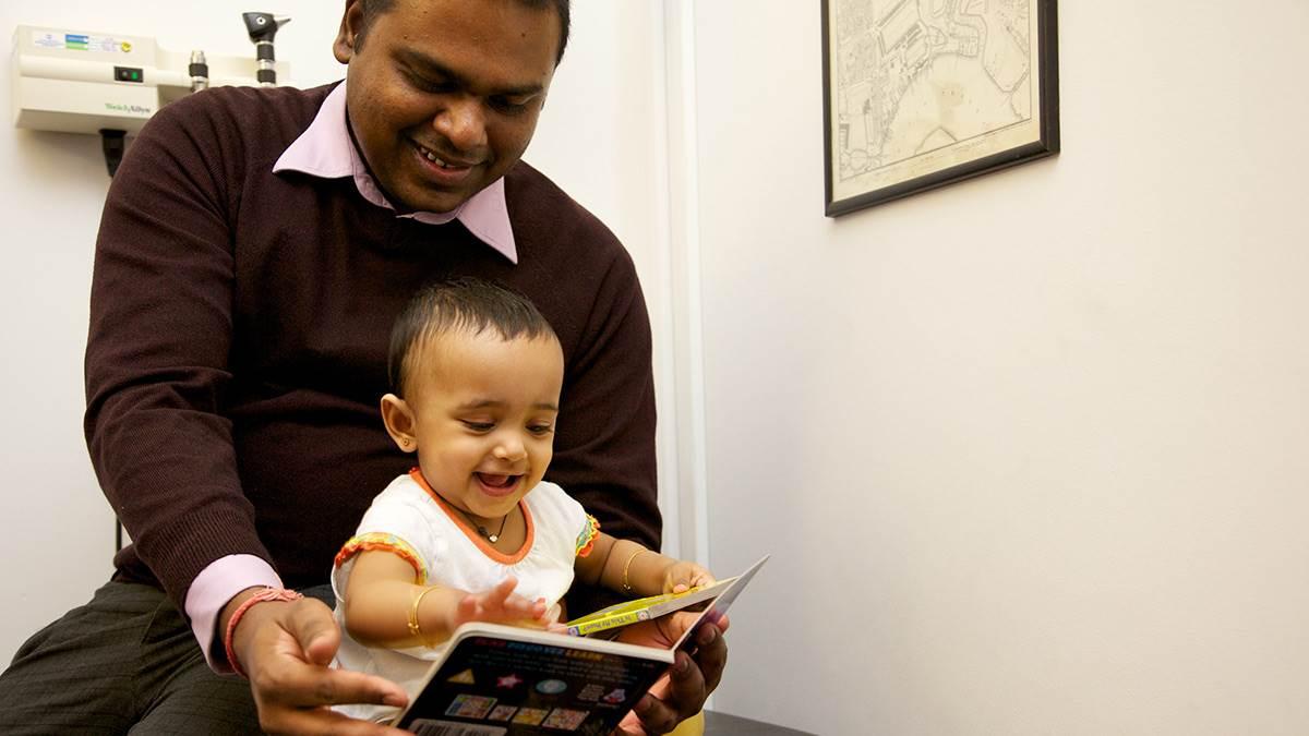 Dad and baby at health check