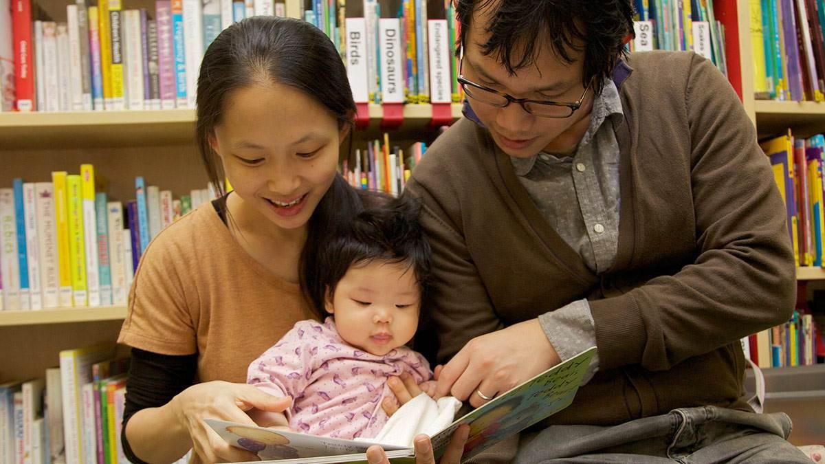 Mum, dad and baby at library