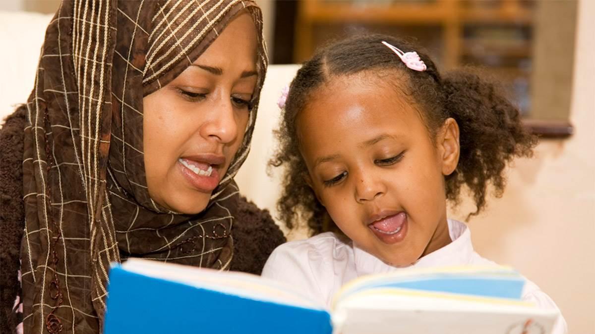Mum and girl reading