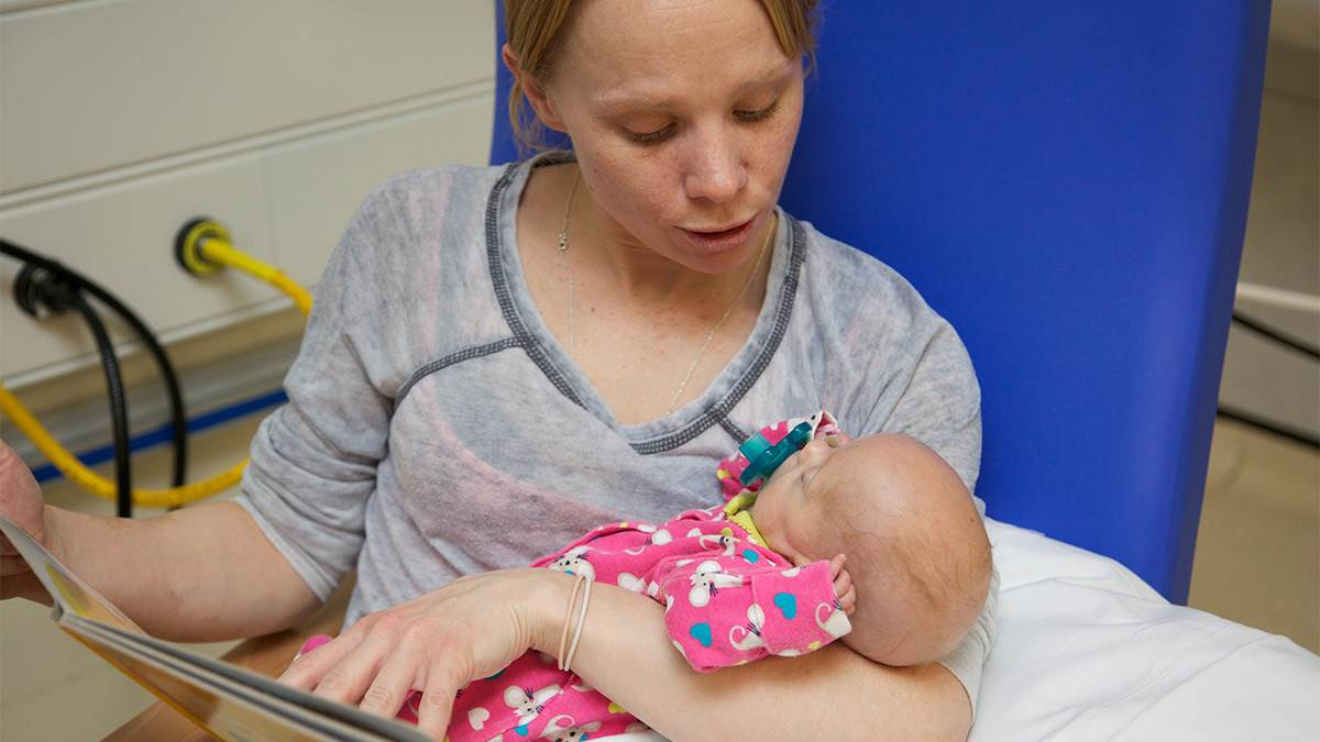Mum and newborn reading