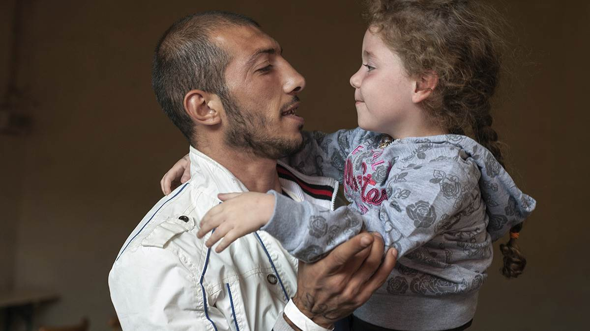 Refugee father and daughter